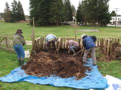 Master Gardener turning compost pile1_3514