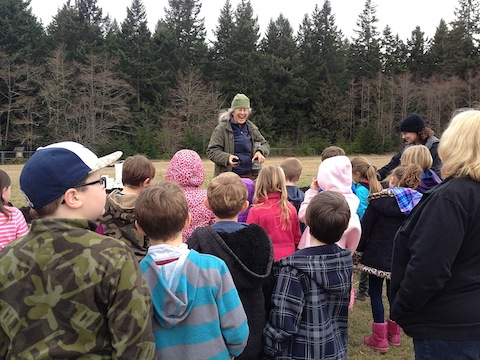 Cary laughs during a soil lesson with 2nd graders