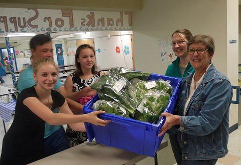 Kathy receiving veggies LMS 23may14 P1340364