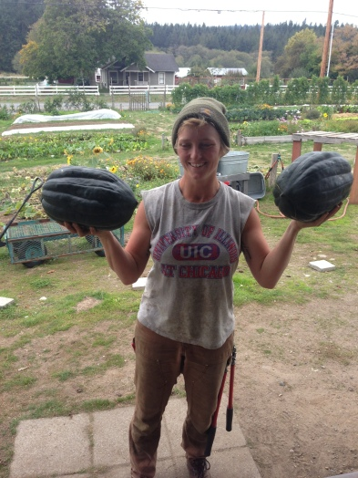 Camille with some seriously large volunteer hybrid winter squash.