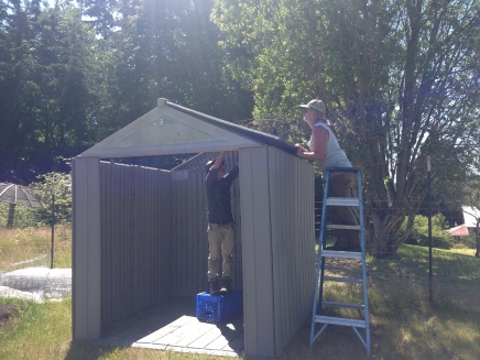 Assembling the tool shed donated by SWSD!