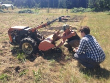 Getting ready to plant with the tractor donated from The Organic Farm School!